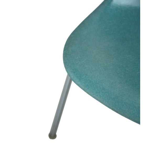 Fiberglass Eames Herman Miller side shell chair in rare turquoise fiberglass. Wide mount; stacking base. One small drilled...