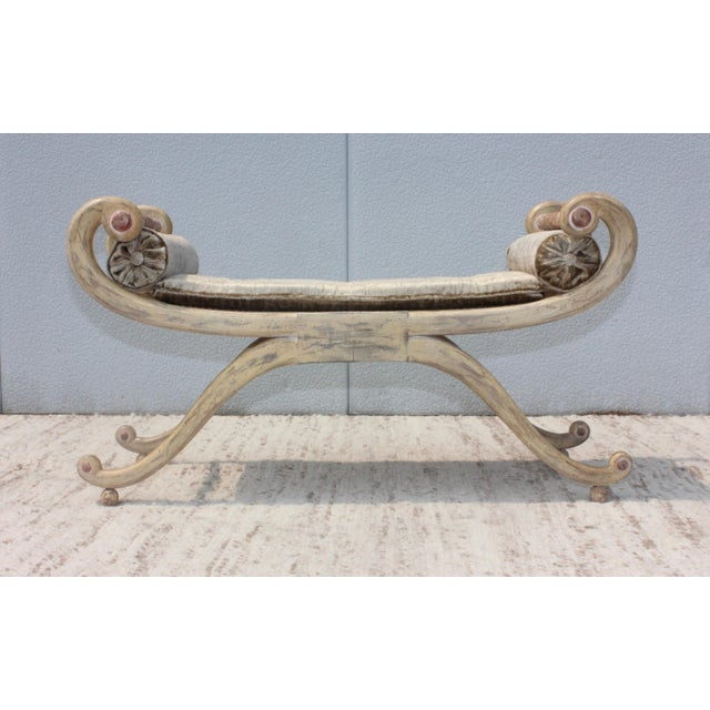 1940s French scroll arm bench in original distressed finish with velvet upholstery.
