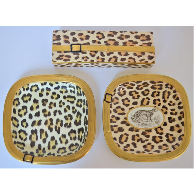 This is a very fun Mid Century Italian Leopard ceramic set in a luggage motif with gold belt design. It was made...