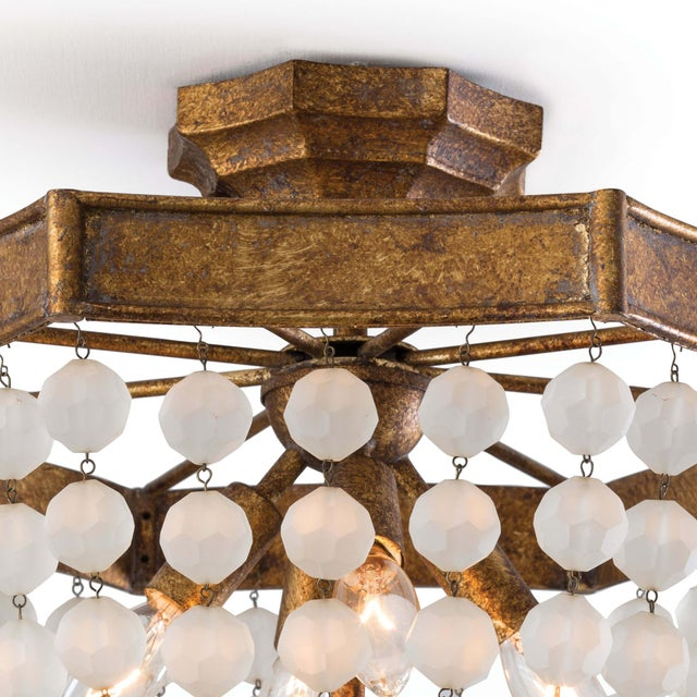 Multiple rows of frosted crystal beads grace the metal frame of this elegant and contemporary semi-flush mount finished in...