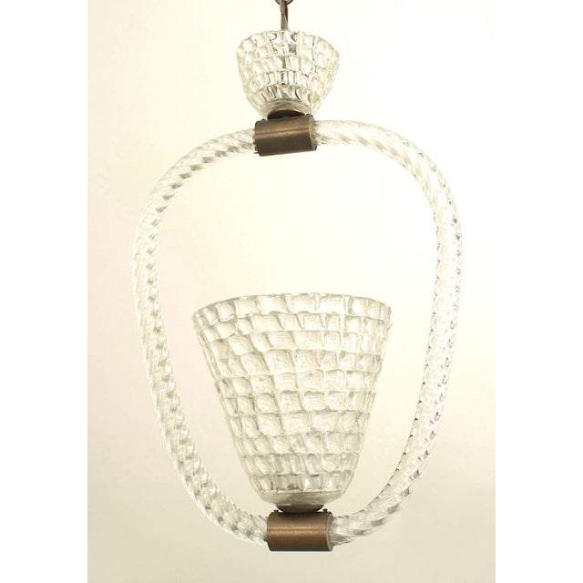 Italian 1940s lantern with a conical shaped centered woven form clear glass shade surrounded by a clear swirl glass ring...