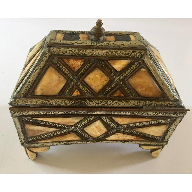 Moroccan decorative footed jewelry box inlaid with camel bone and brass. Moroccan Moorish jewelry box hand-carved all-over...