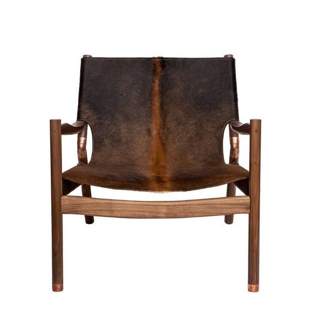 Slung Brindle walnut lounge chair with copper sabots and joint connectors. Designed by Ben Erickson for Erickson...