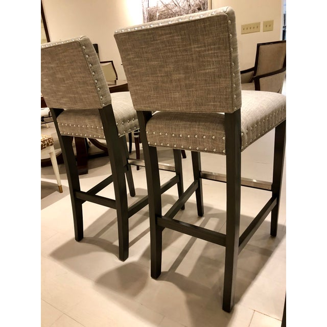 Four Vanguard Newton Barstools (W709-BS) which are new! Never used, currently in showroom. Tarbee Stone fabric, Stainless...