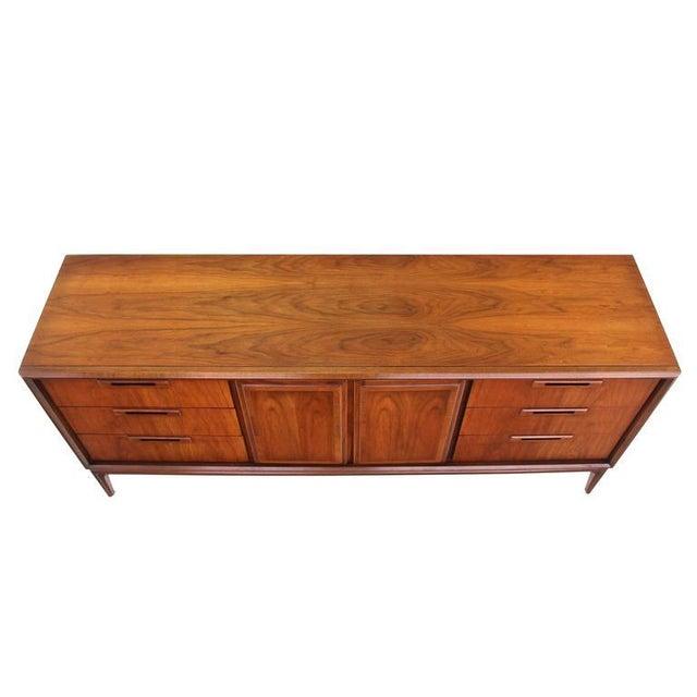 Nine drawer mid century modern walnut credenza dresser. Made in the mid 20th century.