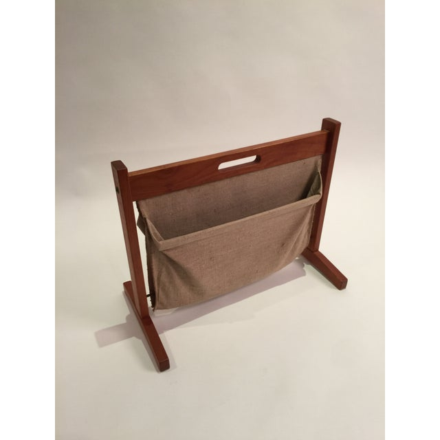 Teak frame with canvas slings. Each with weighted metal to hold pouches open. Great for media or remotes ect. Will ship...