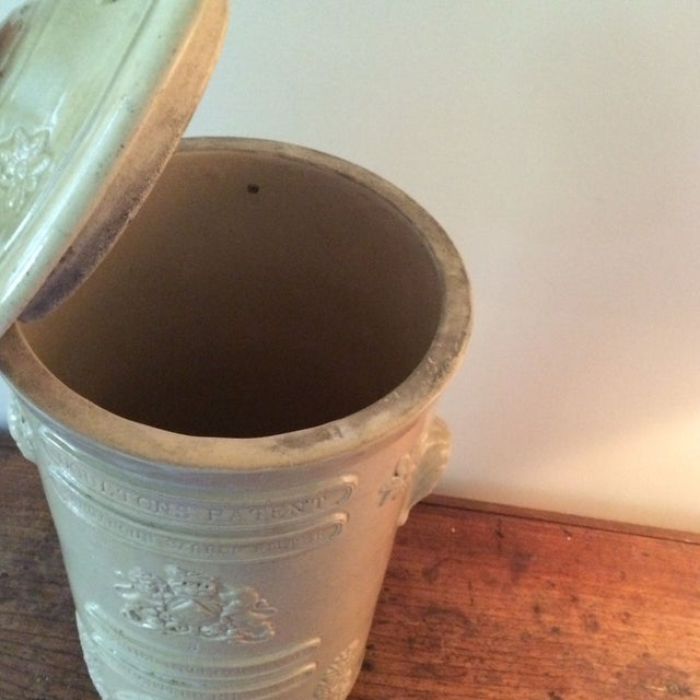 This circa 1880s English ceramic water purifier has lots of character, from its imperfect glazed finish to the antique...