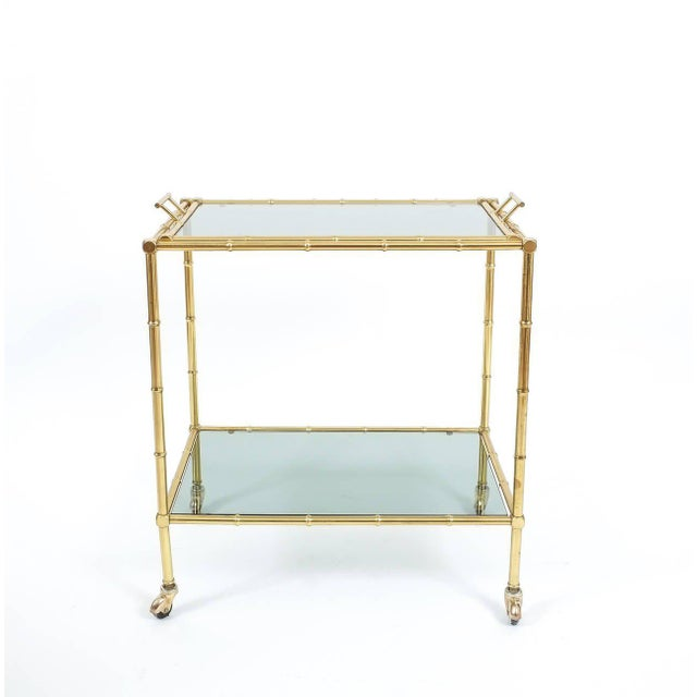 Elegant mid-century liquor or bar cart from France in the tradition of maison Bagues with a removable glass tray and...
