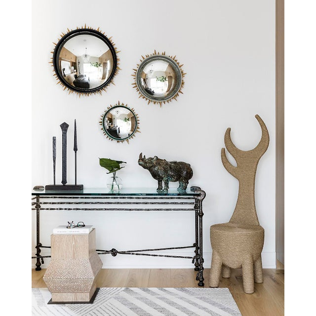 This substantial hammered iron and glass console table is created in the manner of Diego Giacometti. This piece hails from...