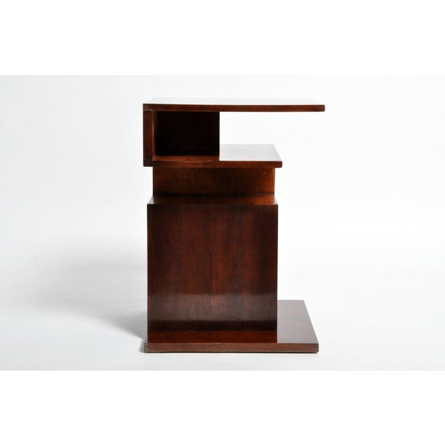 This interesting side table is from Hungary and was made from walnut and maple veneer, circa 1950. The piece features nice...