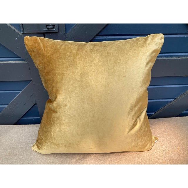 A pillow made from Scalamandre's iconic love bird silk damask, embellished with antique metallic trim and backed with...
