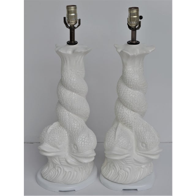This is a pair of Regency Brighton Dolphin white plaster lamps circa 60-70's. They are in excellent vintage condition and...