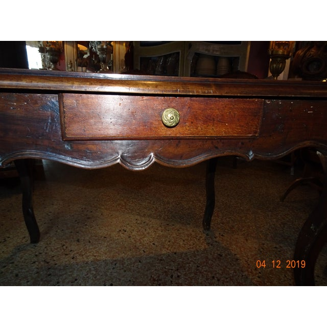 French 18th Century walnut Louis XV period table. Four planks of wood on top, cabriole legs , scallop apron . One drawer...