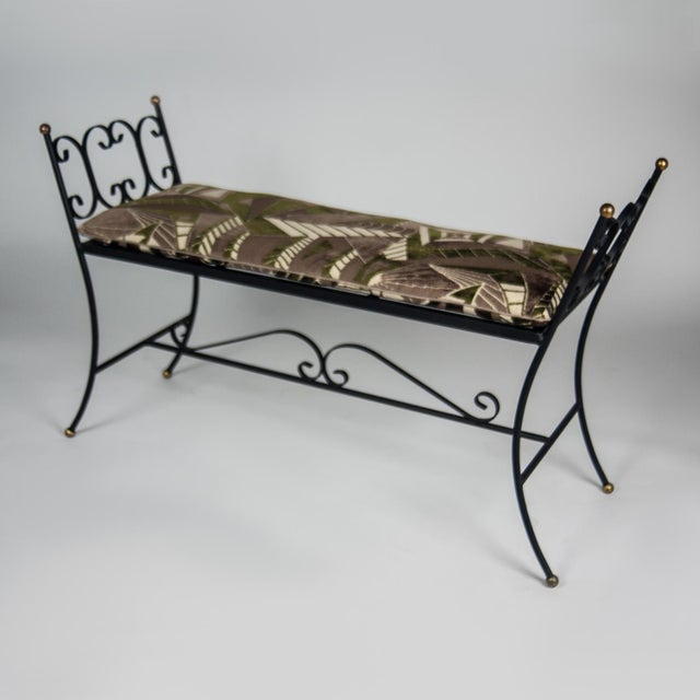 Black painted iron bench with gilded accents and scroll details. All new upholstery and fill, loose seat cushion covered...