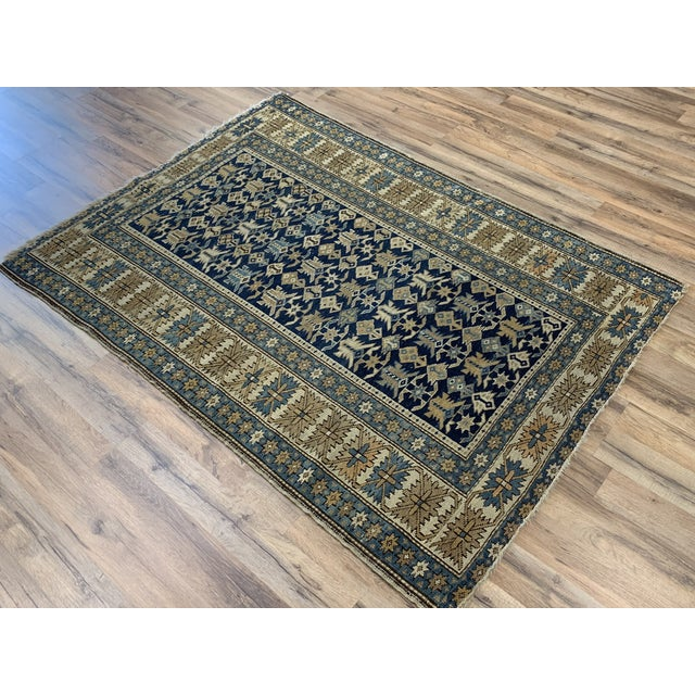 This traditional rug has an incredible amount of detail. The cool blues and earth tones will make a strong statement in...