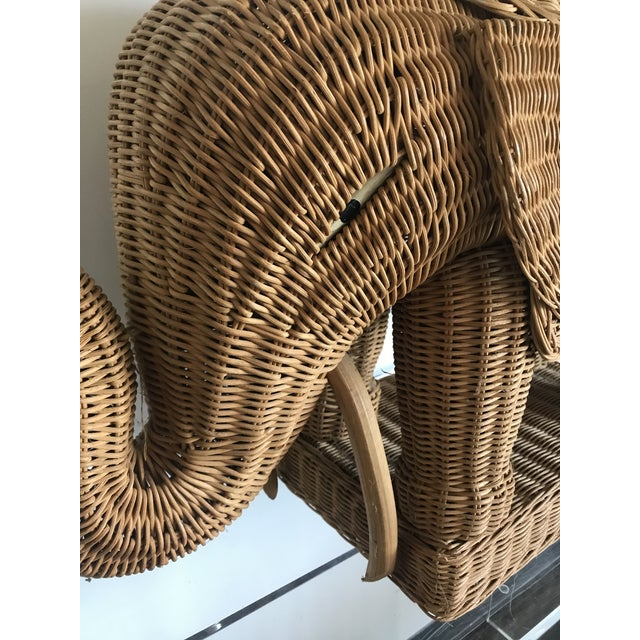 A nice addition to any room, this vintage rattan elephant side table would work nicely in a living room as an accent, a...