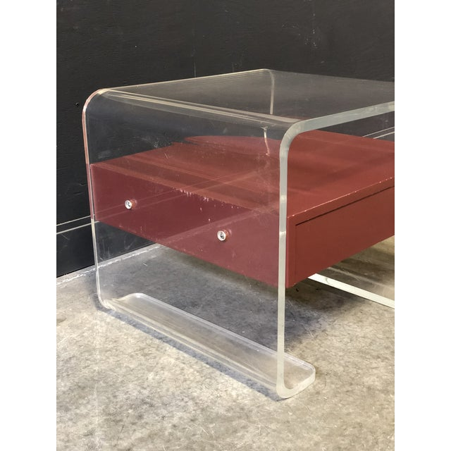 Vintage Lucite side table with one drawer. Waterfall edges, unique design. Very heavy and well made.
