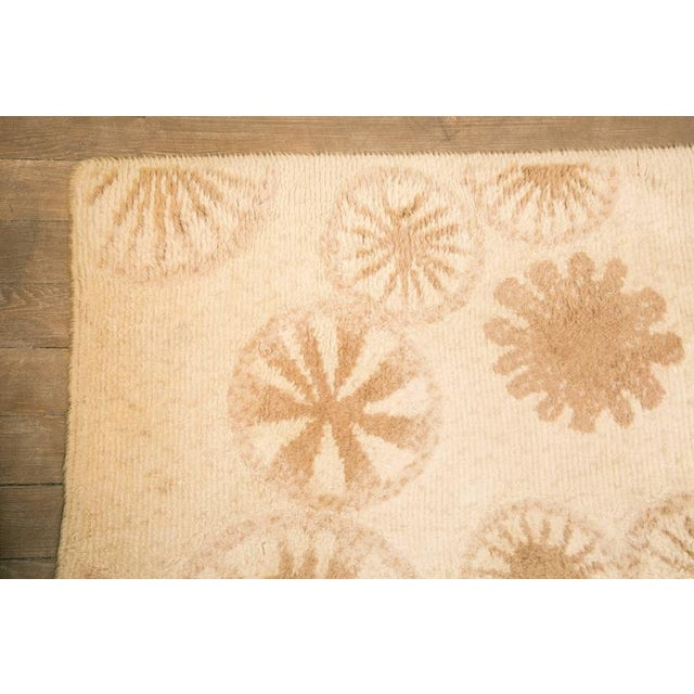 High and low loop pile carpet. Featuring a variety of circles. Hand-knotted, Cogolin, France, circa 1970.