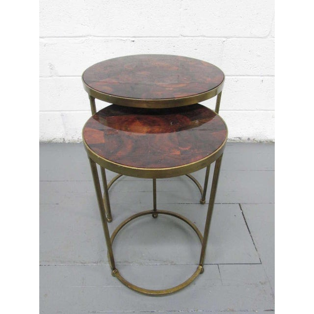 "Tables have painted gold steel frame with parchment top. Taller table measures: 19"" in diameter x 24.25""H."