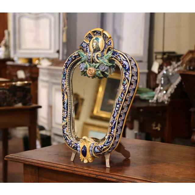 Decorate a counter with this elegant free-standing ceramic table mirror. Crafted in France circa 1860, the colorful,...