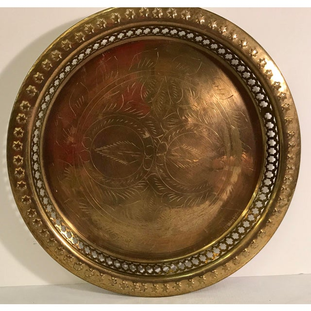 Beautiful vintage brass tray. Pierced and embossed. Stars on edges.