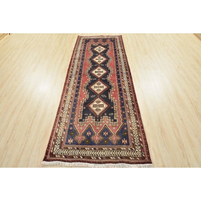 This is an authentic vintage Persian Afshar runner hand-knotted in Persia with an all wool pile on a cotton foundation....