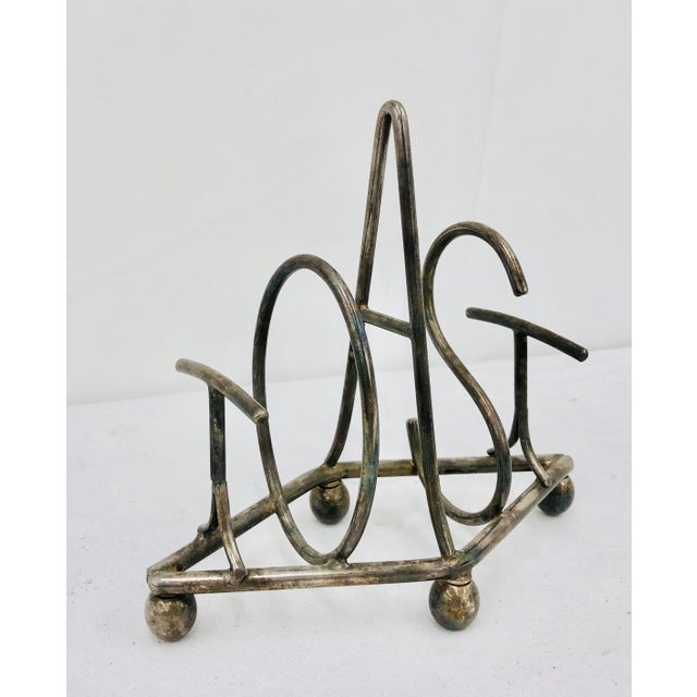 Stunning Antique Silver Metal TOAST bread holder rack. Original finish fittings and frame. Solid and sturdy, sure to stand...