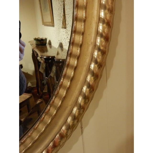 Oval 19th century Italian high-quality gilt mirror with original mercury glass.