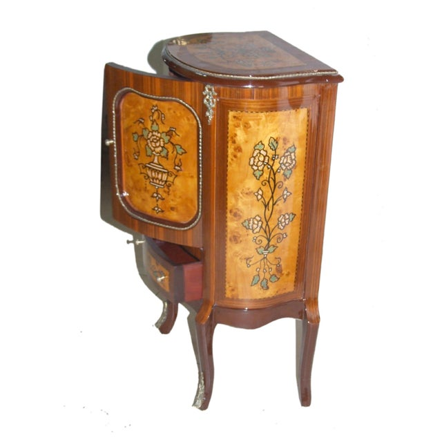 Solid wood cabinet with beautiful woodwork detailing and two different sized storage compartments A beautifully designed...