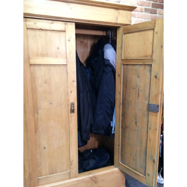 We have used this great antique pine armoire for years for our coats. It has one wooden rod for hanging and a generous...