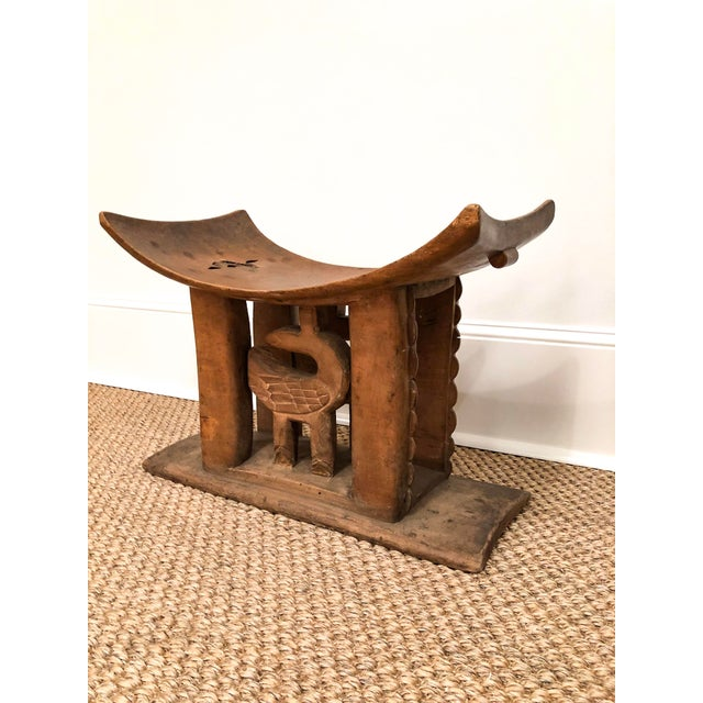 This wood carved Ashanti stool features a scoop seat and decorative carving detail on the body of the stool. Great way to...