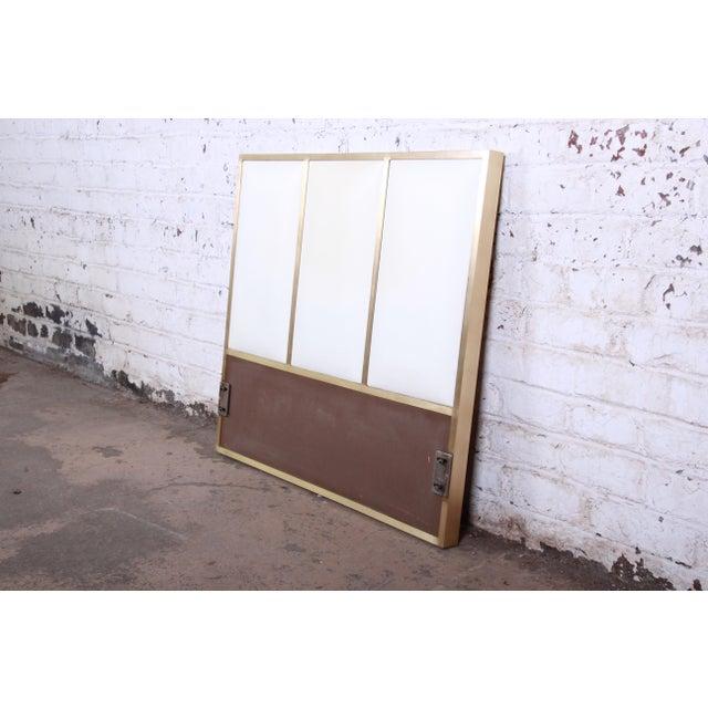 A beautiful mid-century modern Hollywood Regency twin size headboard by Paul McCobb for Calvin Furniture. The headboard...