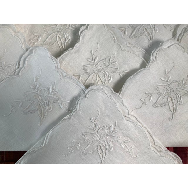 A set of 8 hand embroidered white on white linen napkins, starched pressed and ready to serve!