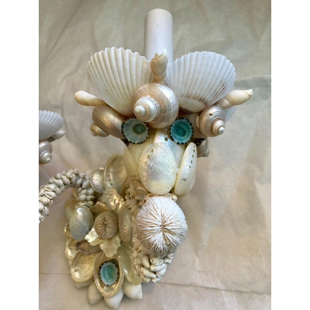 Graceful pair of two-light wall sconces decorated in white Seashells and Abalone, with touches of Turquoise Mexican...