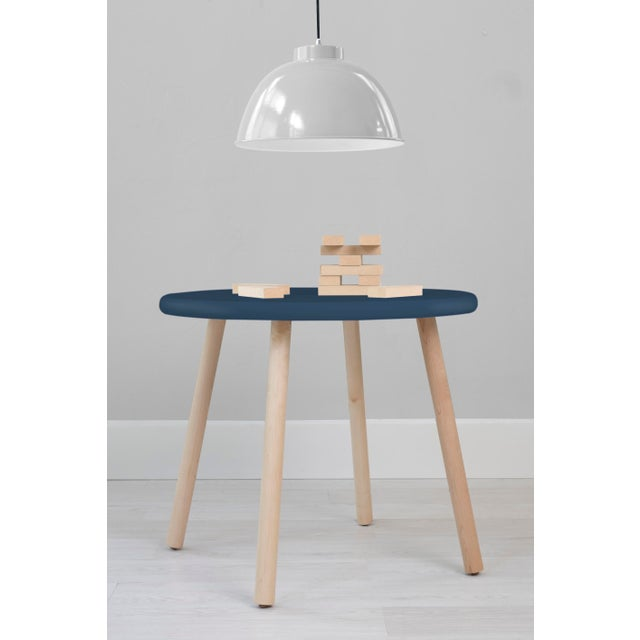 "Peewee Round 23.5"" Maple Kids Table. Our Peewee table has a sleek modern look and provides plenty play space with a 23.5""..."