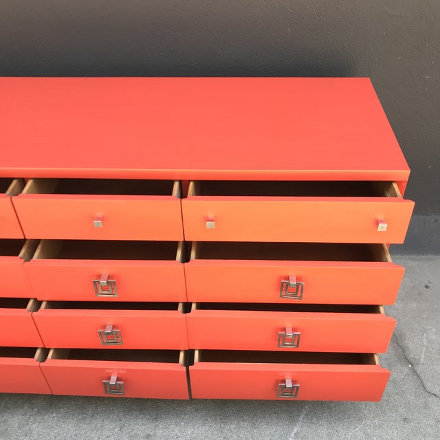 Beautiful restored 12-drawer MCM lacquered fire orange dresser! Clean drawers with dovetail joints. A stunning piece that...