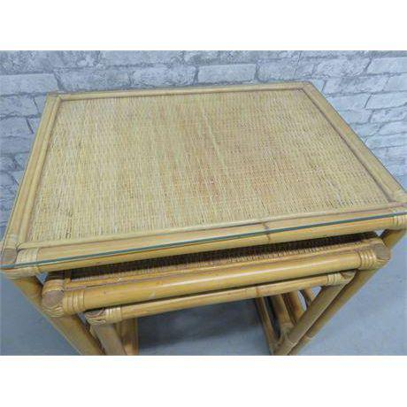 Vintage rattan bamboo nesting side tables. Largest one has removable glass top. These are great for entertaining.