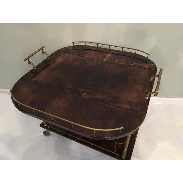 Vintage bar cart by Aldo Tura features lacquered goat skin parchment and brass hardware. Purchased in early 1950s in...