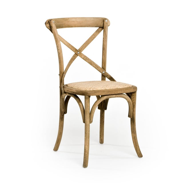 Cross-back stool with rattan seat in natural finish.