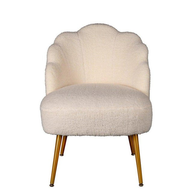 The perfect fusion of playful and sophisticated, the fabulous Kayla Chair boasts stainless steel legs in gold finish...