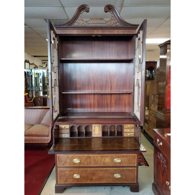 Gorgeous Bookcase secretary by Baker Furniture from the Collector's Edition. Topped with a filigreed interrupted pediment,...