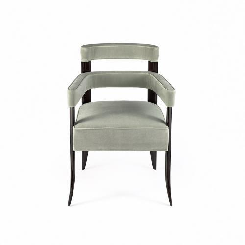 The Paolo Arm Dining Chair by Studio Van den Akker was designed to work with the Paolo side dining chair and is available...