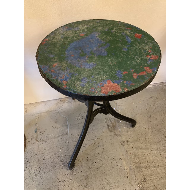 Stunning chippy paint cast iron table in good condition. Made in the 1940s.