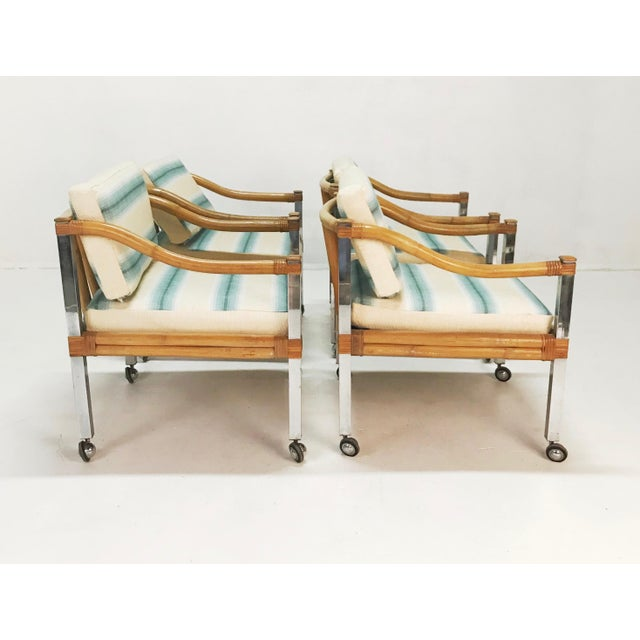 Fantastic chrome and wrapped rattan and bamboo arm chair set by Four Season's Rattan. Super comfortable arm chairs on...