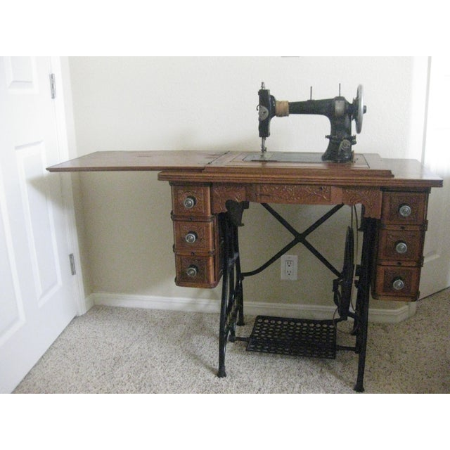 This is a beautiful vintage sewing machine table and storage cabinet. The cabinet houses the original White sewing...
