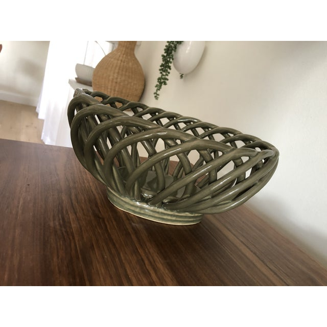 Green ceramic woven bread bowl. Unique army green color. Perfect condition. 10 1/2 inches wide 9 inches deep 5 inches high...