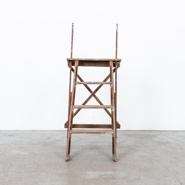 Practical and beautiful folding wooden step ladder. Great neutral patina of white and black paint drips.