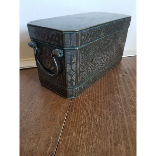 Beautiful antique heavy bronze and silver inlay box with handles and interior sections with lids.