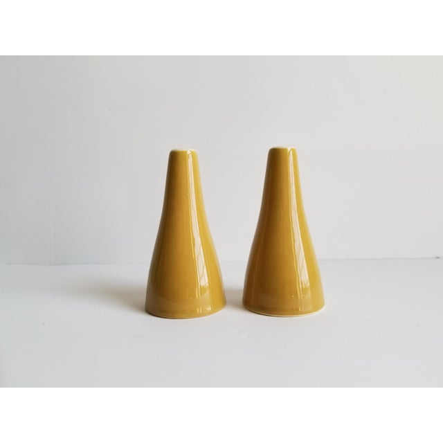Very nice vintage mid 20th century modern ceramic salt and pepper shakers in a camel gold tone.They are in perfect...