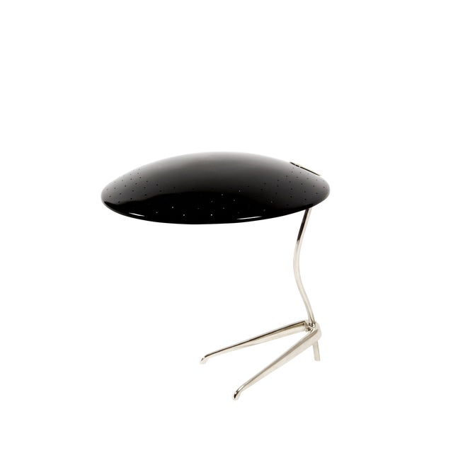 With a discrete size, Meola table lamp is a design by DelightFULL that successfully showcases the merge between mid-...